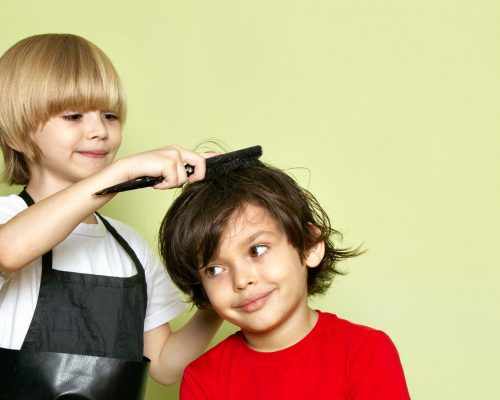 front-view-little-cute-hairdresser-adorable-kid-working_2