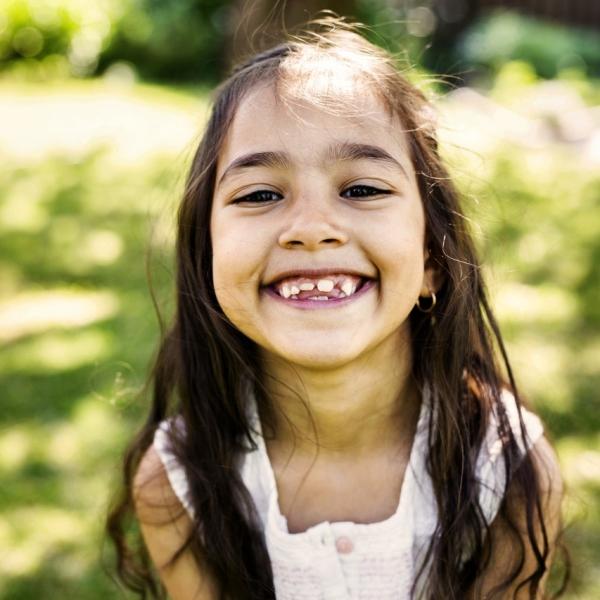 Girl (6-7) smiling